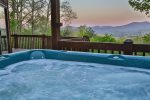 Relax in the Hot Tub overlooking the mountain tops