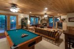 Terrace level great room with a pool table