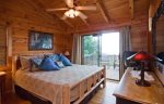 King master bedroom on the upper level with a private deck