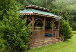 You can relax in the shared gazebo right on the creek
