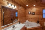 Full bathroom on the main with a large tub and a walk-in shower