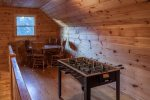 Loft area with a foosball table and game area
