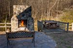 Outdoor fireplace overlooking the Cartecay River