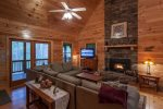 Great Room overlooking the Coosawattee River with a wood burning fireplace and 42 inch flat screen TV