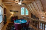 Game room with a bumper pool table and a electronic dart board