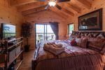 King Size Master bedroom upstairs with a flat screen TV and private deck with killer mountain top views
