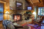 Great Room with a wood burning fireplace and a TV