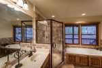 Master bathroom on the main level with dual vanity,large jetted tub and a custom tiled shower