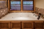 Master bathroom with a large jetted tub. Can you see yourself relaxing here