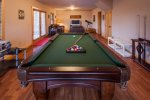Terrace level with a flat screen tv and pool table