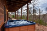 Hot tub on the terrace level overlooking the beautiful mountains