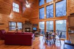 Greatroom with floor to ceiling windows overlooking the beautiful mountains