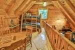 Quaint loft area with bunk beds