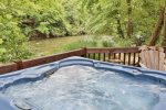Take a dip in the hot tub with river views