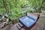 Look out over the river as you enjoy the hot tub