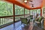 Enjoy a glass of wine and good conversation on the screened deck