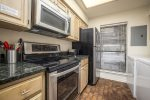 Comfortable King Size Bed with full view of the Comal River. Direct access to the oversize patio.