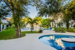 Gated Playacar Townhome w/Lush Surroundings & Golf