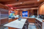Full gourmet kitchen with breakfast bar and stainless steel appliances