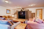 East End Retreat - Downstairs media room with comfortable seating and large flat screen TV