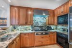 Fabulous updated kitchen with gas range, granite counter tops