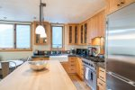 Spacious, modern kitchen with granite counters, wood island