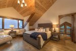 Master bedroom with king-sized bed and vaulted ceilings