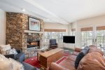 Incredibly comfortable living area with a gas fireplace and flatscreen TV