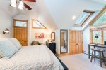 The master suite upstairs is warm and inviting with lots of natural sunlight