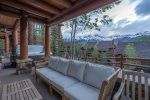 Revel in the mountain views and comfortable outdoor furniture