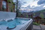 Enjoy a soak in your private hot tub just steps from your outdoor living space