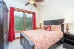 Queen sized guest room with outdoor views