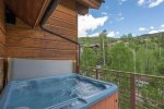 Soak in your private hot tub with mountain views