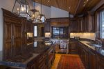 Custom walnut cabinets throughout the gourmet kitchen