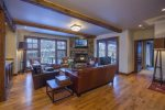 Lower level great room has a large flat screen TV, gas fireplace and wet bar