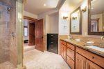 Walk past the walk-in closet into a large bathroom with heated floors and dual sinks