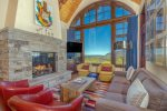 Pops of color in the living room accent the gorgeous views that pour in from outside