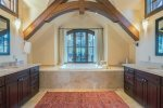 Soak away the day in the master bath`s soaking tub