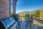 Grill up something tasty on your private deck with great mountain views