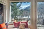 The spacious deck has unobstructed views up Bear Creek