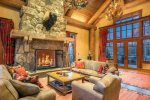 Stately great room with a stone surround wood burning fireplace