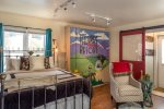 A cheery Telluride mural hides the fold down trundle beds