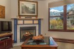 Flat screen TV and gas fireplace with great views from the living room
