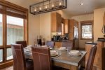 Enjoy a meal at the dining table or sit at one of the 2 breakfast bar seats