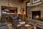 Stone mantle with gas fireplace and big views