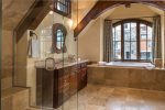 Private en suite bathroom with soaking tub, steam shower, double vanities