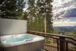 Large hot tub located on ground floor, accessed through ski locker room