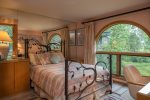 Master bedroom with a queen-sized bed and river view