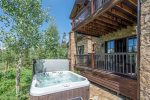 Soak in your own private hot tub right off of the deck