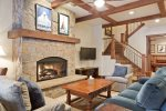 Gather around the fireplace in the second downstairs living area